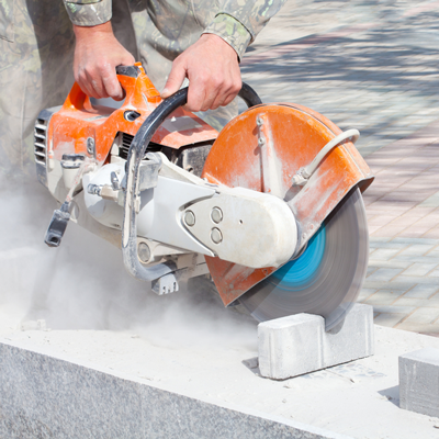 person-sawing-through-concrete-using-a-power-saw